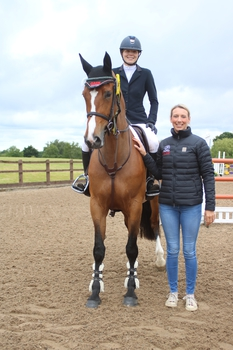 Charlotte Arnold is victorious in the Equitop Myoplast Senior Foxhunter Second Round at Dean Valley Equestrian Centre