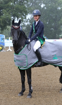 Hannah Barker wins the Charles Britton Equestrian Construction Winter JA Classic Championship