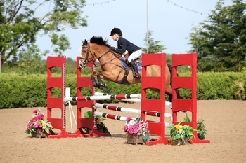 Claudia Moore wins The Stable Company HOYS 138cms Qualifier at The College Equestrian Centre, Keysoe