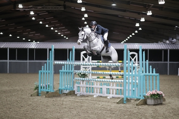 Alex Thompson takes the top spot in The Champagne Cave Winter Grades B & C Qualifier at The College Equestrian Centre, Keysoe