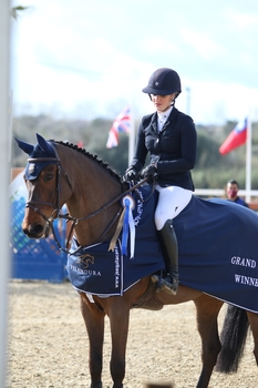 Lily Freeman-Attwood claims the CSI 3* Vilamoura Grand Prix