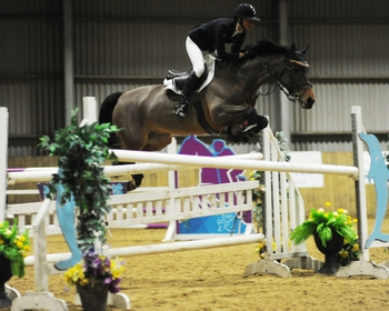 Chloe Reynolds takes the top spot in The Champagne Cave Winter Grades B&C at Onley Grounds Equestrian Centre