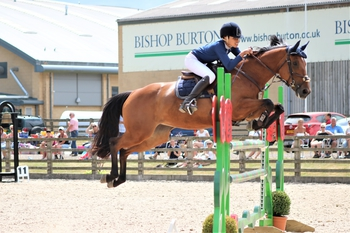 Berkshire's Tatiane Mauree heads up the Blue Chip Pony Newcomers Second Round at Bishop Burton College