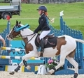 8 year-old Scarlett McDonald celebrates her success in the Club 60 & 70cm Championships